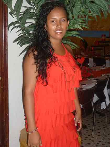 A photo of a Colombian woman in an orange dress